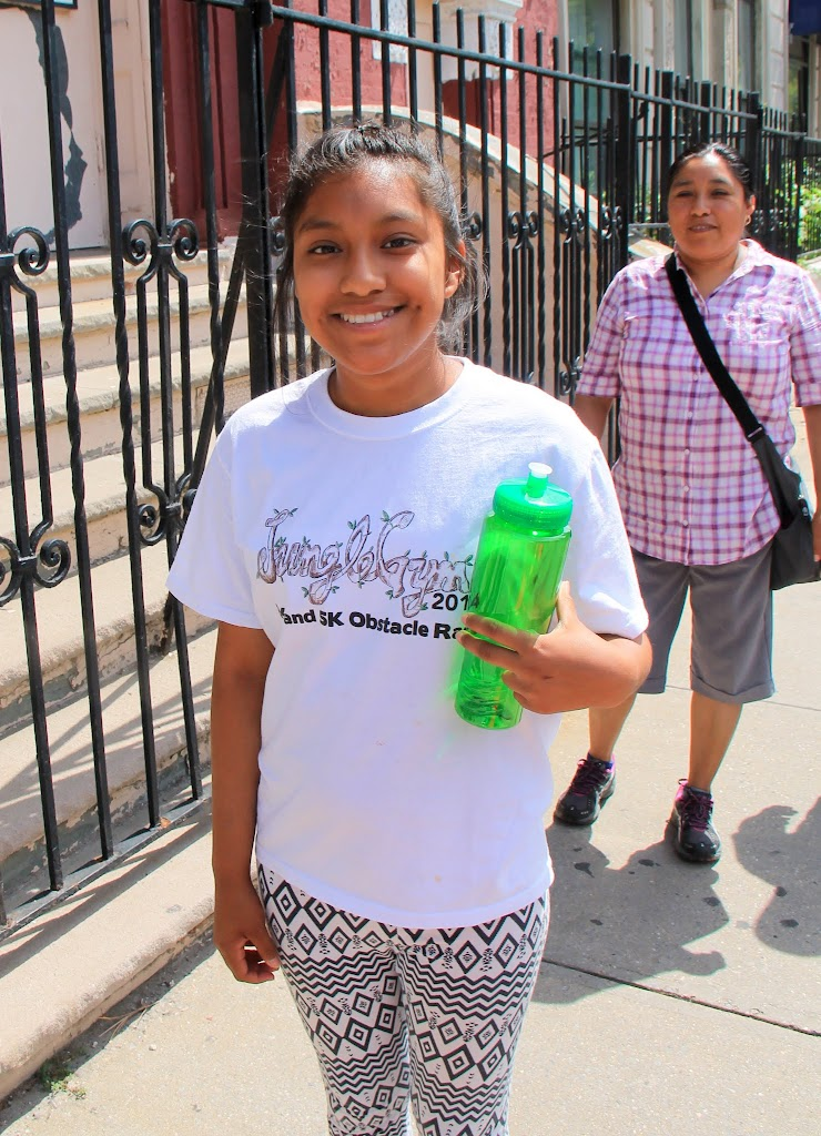 Showing off her Cada Paso water bottle and Jungle Gym shirt