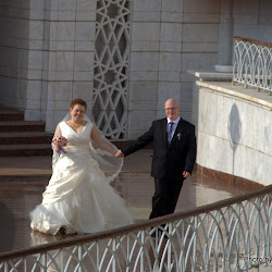 A beaming Muslim couple comes out of Kul Sharif Mosque