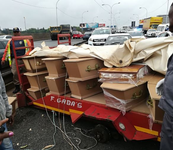 "Johannesburg Metro Police Chief Superintendant Wayne Minnaar said, ""[The] wheels came off [the] trailer. Some boxes containing… dead bodies [were dropped]'"" said Minnaar."