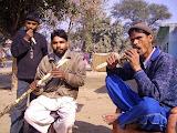 Villagers eating sugar cane