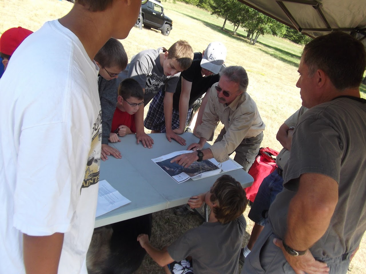 Looking over a map on the entire area and what the habitat is all about.