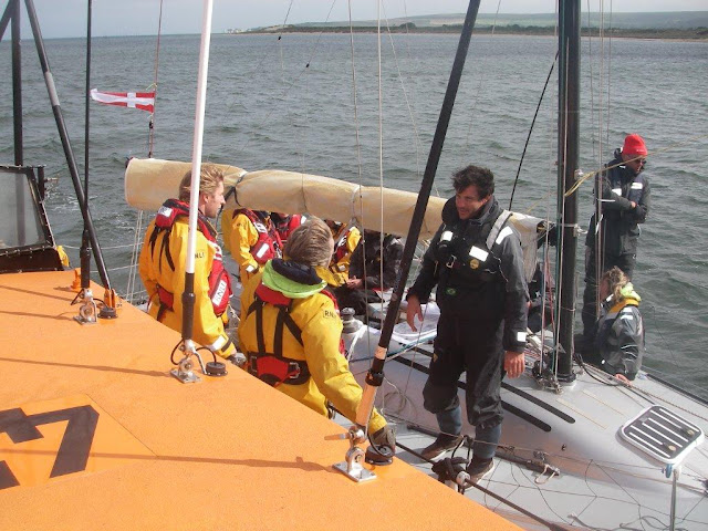 Poole crew talking to the crew of the French yacht that was racing from Cowes to Dinard on Friday 13 July. Photo: RNLI Poole/Dave Riley