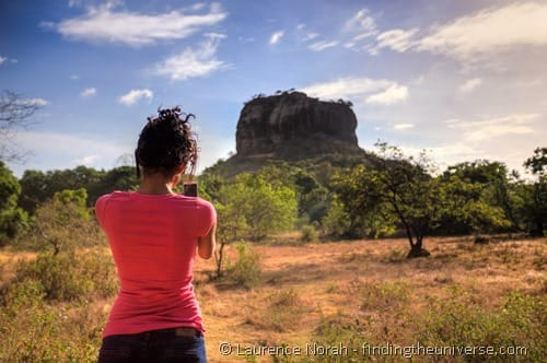 Girl taking photo of Sigiriya Sri Lanka