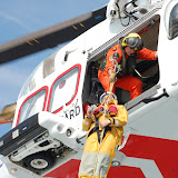 Crew member being lifted during a helicopter exercise with Portland Coastguard
