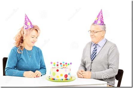 middle-aged-couple-sitting-birthday-party-looking-cake-isolated-white-background-36640559