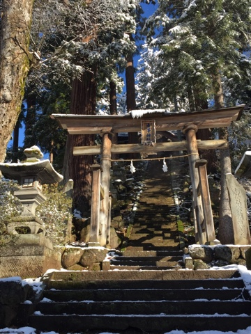 Snow covered torii gate at Nozawa Onsen, Nagano on Christmas day