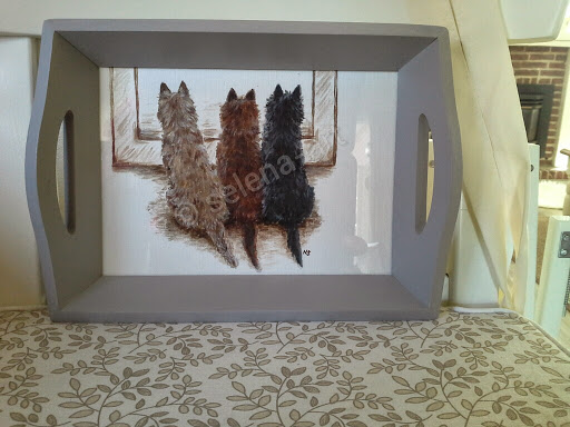 Dienblad met drie Cairn Terriers
