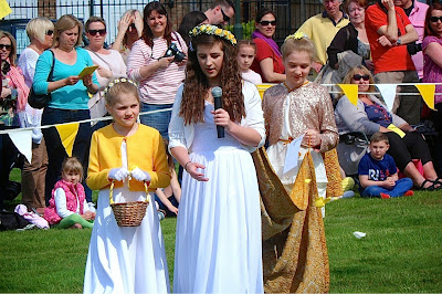 2014 The May Queen and Prince, together with Flower Girl Imogen Mole, during the Crowning Ceremony