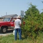 Owen sprays around cemetery sign