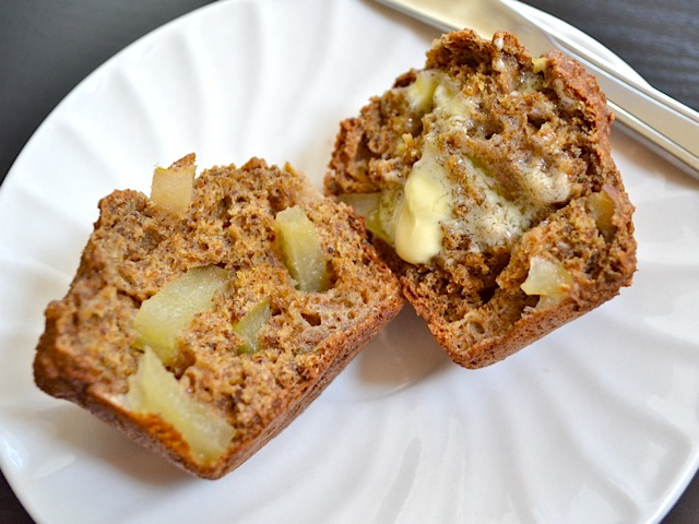 apple flax muffin cut in half and placed on white plate