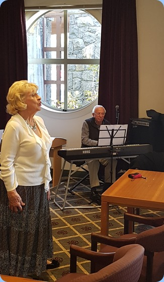 Margaret Black singing with Rob Powell accompanying on digital piano.