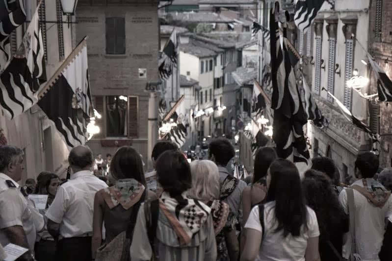The members of the Lupa neighborhood after the Palio