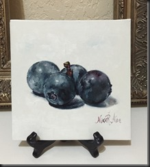 four on easel blueberries