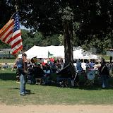 5th MI Regimental Band play under the shade of an oak