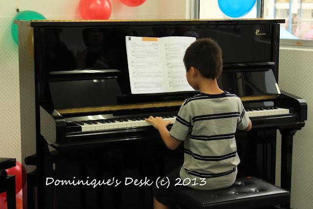 Monkey boy playing the piano