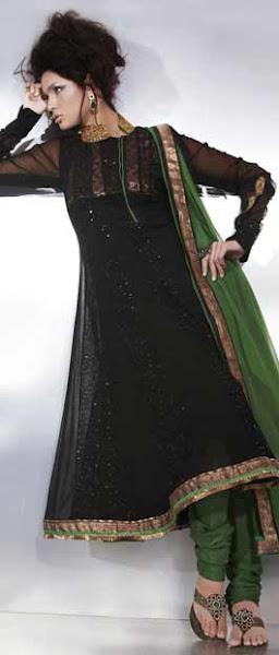Photo: Black Net Flare Style Churidar Kameez  Itemcode: KCR3793  Price: US$ 109.47  Shop @ http://www.utsavfashion.com/store/sarees-large.aspx?icode=kcr3793