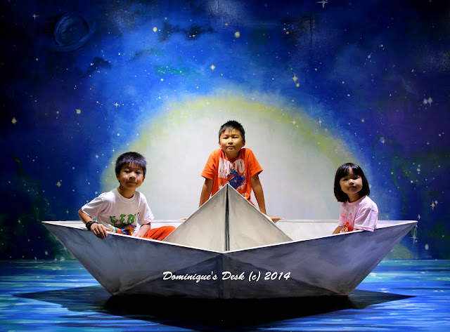 The kids in a paper boat