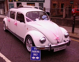 white VW beetle 4door stretch wedding car