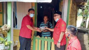 Harlah 48 Tahun PDIP, Wakil Bupati Muratara dan Pengurus DPC Bagikan Tumpeng Ke Warga