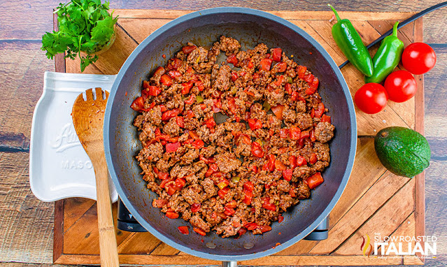 ground beef and tomatoes in a skillet