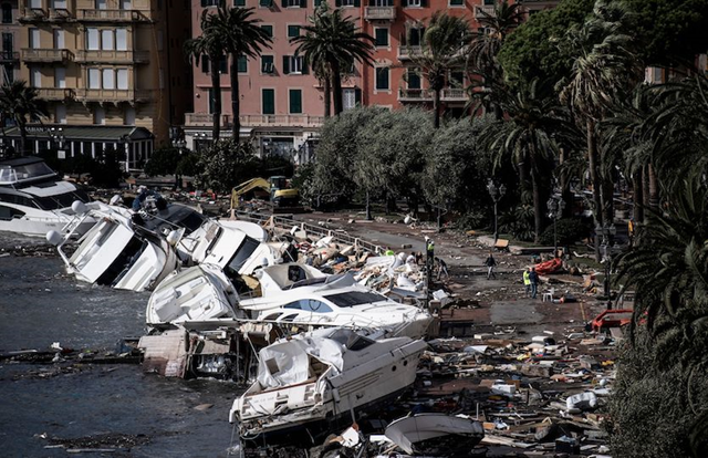 Destroyed yachts and boats lie in the harbour of Rapallo, near Genoa, on 30 October 2018, after a storm hit the region and destroyed a part of the dam the night before. Photo: Marco Bertorello / AFP / Getty Images
