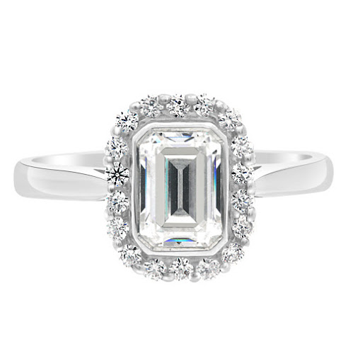 Monica Engagement ring. Emerald cut diamond bezel set in a halo of round brilliant diamonds. #engagementring...