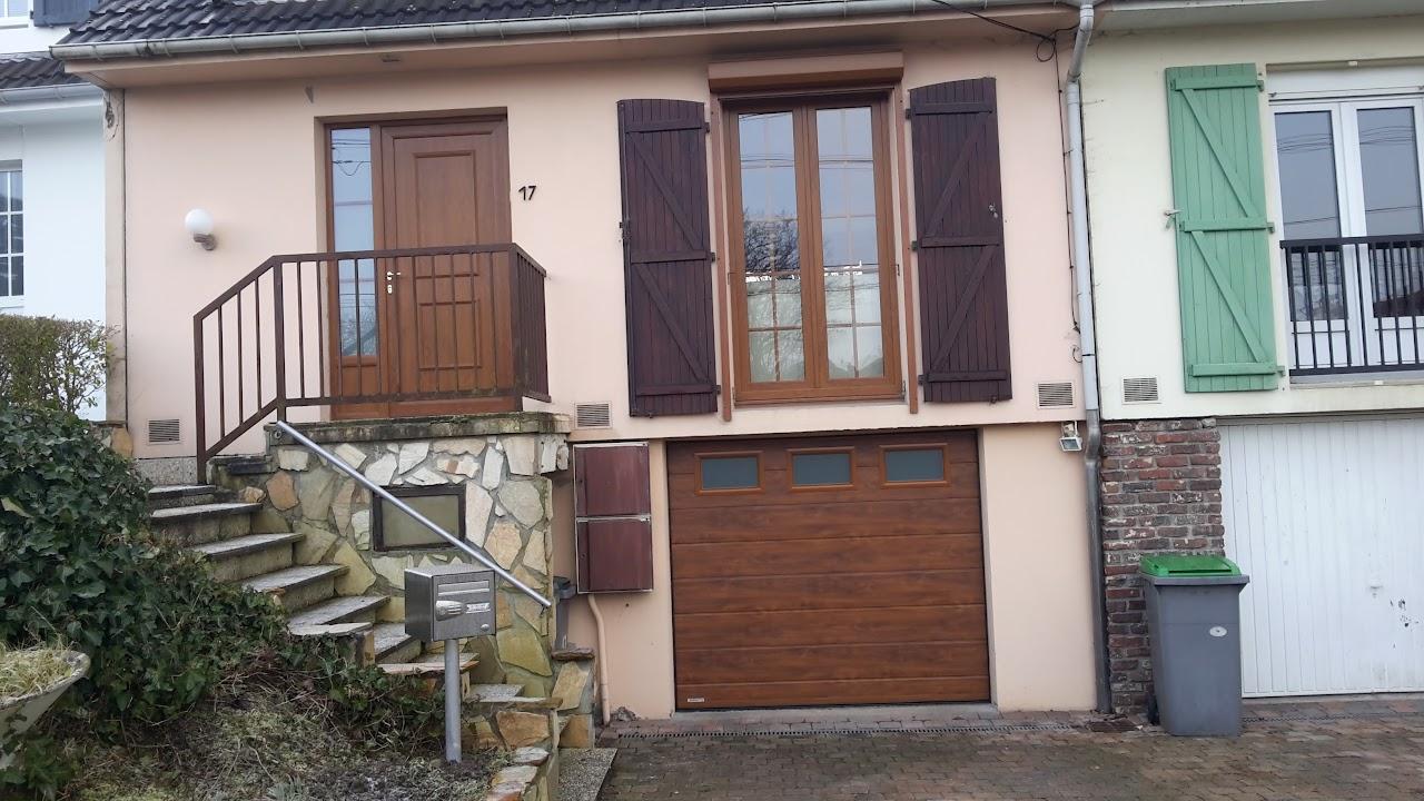 Porte de garage sectionnelle vente et pose roncq for Garage rue caumartin lille