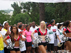 Mayor Kasim Reed lining up behind the Atlanta Falcons cheerleaders at the starting line.