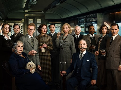 "L-r, (standing) Olivia Colman as Hildegarde Schmidt, Josh Gad as Hector MacQueen, Willem Dafoe as Gerhard Hardman, Daisy Ridley as Mary Debenham, Thomas Bateman as Bouc, Michelle Pfeiffer as Caroline Hubbard, Derek Jacobi as Edward Henry Masterman, Leslie Odom Jr. as Dr. Arbuthnot, Penélope Cruz as Pilar Estravados, Johnny Depp as Edward Ratchett, Judi Dench as Princess Dragomiroff (seated left) and Kenneth Branagh as Hercule Poirot (seated right) star in Twentieth Century Fox's ""Murder on the Orient Express."" Photo © 2017 Twentieth Century Fox FIlm Corp."