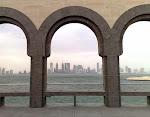 1280px-Doha_Towers_Through_Arabian_Arcades.jpg