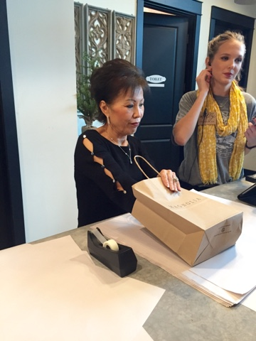 Joanna S Darling Mother Wring Up Packages And Working Behind The Desk