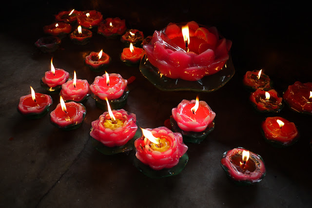 lotus shaped candles in a temple in Zhuhai, China