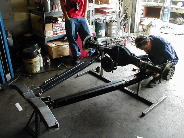 Here is a picture of the Torque Tube Eliminator Kit being installed.. Get one from Hot Rods To Hell