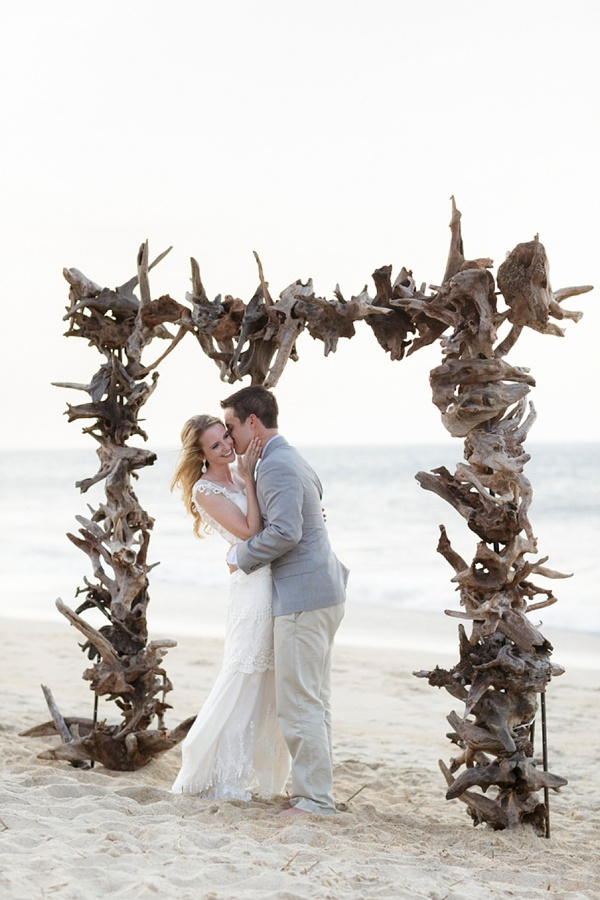 Ruggled driftwood beach wedding ceremony arch