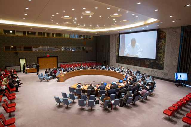 A wide view of the Security Council Chamber as Mohammed Ibn Chambas (shown on screen), Special Representative of the Secretary-General and Head of the UN Office for West Africa and the Sahel (UNOWAS), addresses via video teleconference, 26 May 2016. Photo: Loey Felipe / UN Photo