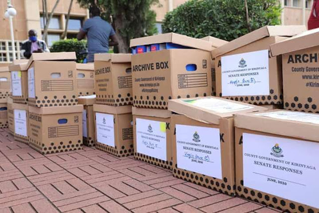 Boxes of files to the Senate.
