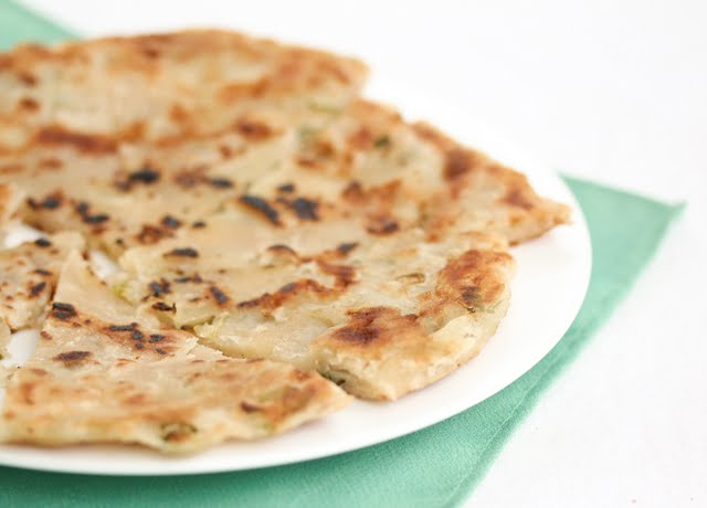 photo of a scallion pancake on a plate