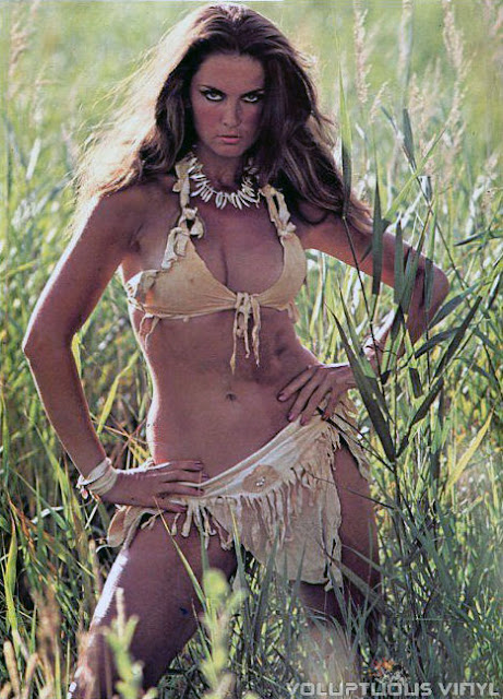 Caroline Munro sexy tan bikini and bone necklace.