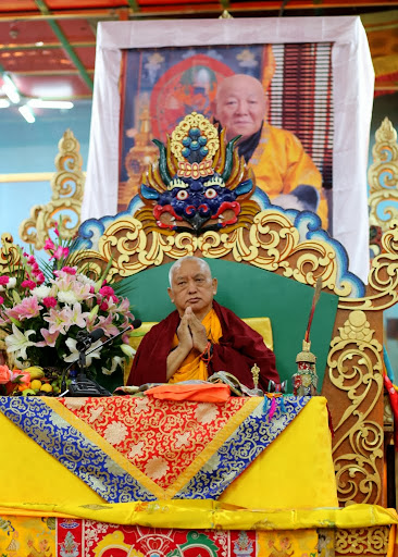 Lama Zopa Rinpoche teaching at 100 Million Mani Retreat in front of photo of His Holiness the 9th Bogd Jetsün Dampa Rinpoche, the head lama of Mongolia, Idgaa Choizinling Dratsang, Ulaanbaatar, Mongolia, August 15, 2013. Photo by Ven. Thubten Kunsang.