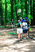the group pulling him up the zip