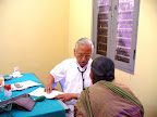 Dr.T.N.Kuppusamy attending a patient :: Date: May 14, 2007, 11:13 AMNumber of Comments on Photo:0View Photo