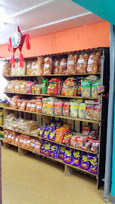 At Portland Mercado's Fiesta Tradicional Pinatas and Candies browse the fun Mexican candy or chips or other snacks