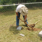 Owen digs out hole to place marker.