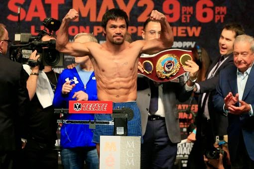 Manny-Pacquiao-poses-shirtless-weigh-in