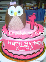 Girl's pink and brown butter cream custom 1st birthday cake design with 3D owl and number 1 topper