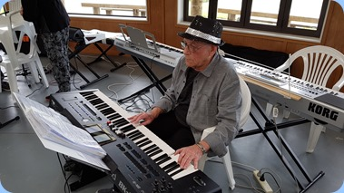 Laurie Concer playing his Roland BK-9 keyboard.