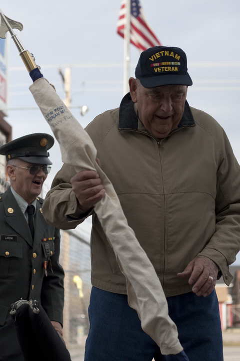 Ken Wersland and Chuck Larum carry flags into VFW Post 5652 after a ceremony held at the Ronan Cemetary on Veterans' Day Friday. Both are veterans of the Vietnam war. Wersland served in the United States Air Force and Larum in the Army. Photo by Will Freihofer.