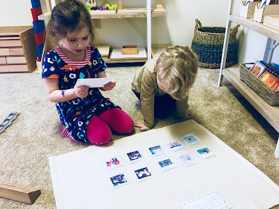 Montessori kids reading spring themed questions for a matching activity