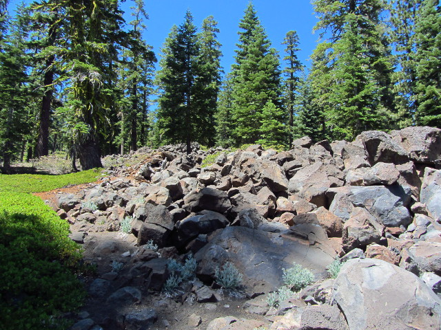 an outcrop of lava rocks on the cinder ground