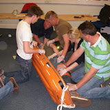 Casualty Care for Lifeboat Crew course – April 2011: crew using a log roll technique to place a casualty with suspected spine injuries into a basket stretcher
